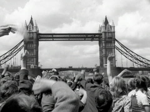 Children wave at Tower Bridge during a pleasure boat cruise along the River Thames 1950