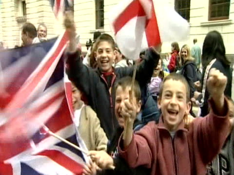 children wave union jacks at the camera during the golden jubilee celebrations in london - golden jubilee stock videos & royalty-free footage