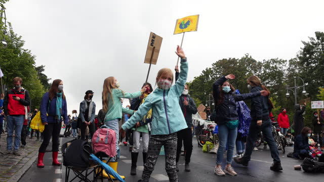 """children, wearing protective face masks, who said, they did not mind being photographed, gather on a """"global day of action"""" organized by the 'fridays... - joy stock videos & royalty-free footage"""
