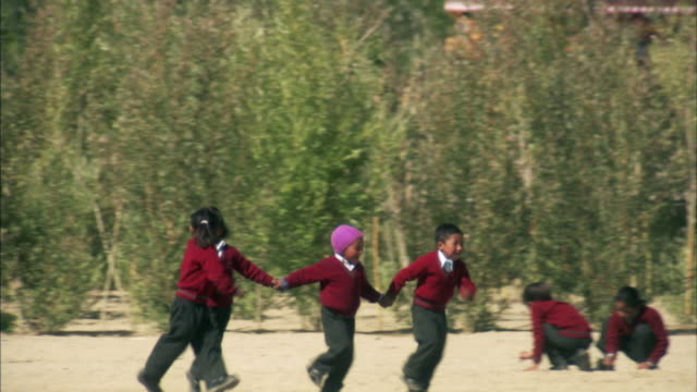 ws, pan, children (6-7, 8-9) wearing school uniforms playing outdoors, ladakh, jammu and kashmir, india - school uniform stock videos and b-roll footage