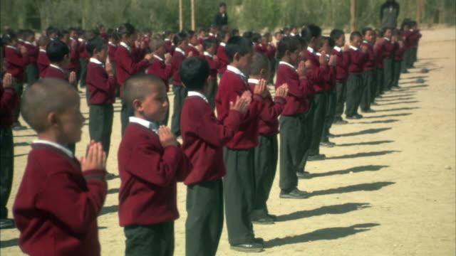 ms, children wearing school uniforms praying outdoors, ladakh, jammu and kashmir, india - conformity stock videos & royalty-free footage