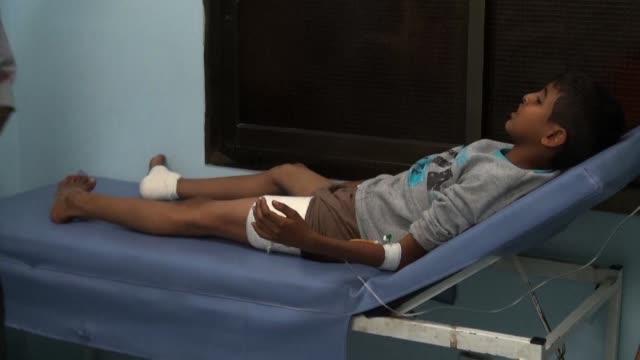 children were injured in al kawather area in taez yemen on wednesday following shelling in the city - yemen stock videos and b-roll footage