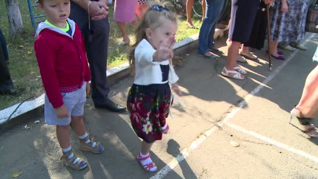 Children were returning to school for the start of term in Ukraines troubled east on Monday though in rebel held Donetsk schools remained closed...