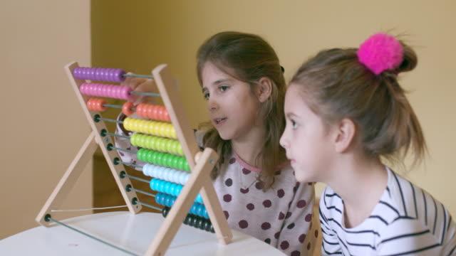 Children with abacus, handheld shot