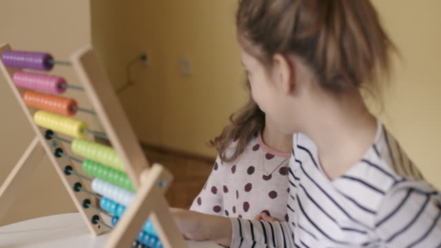 Children with abacus, slow motion, handheld shot