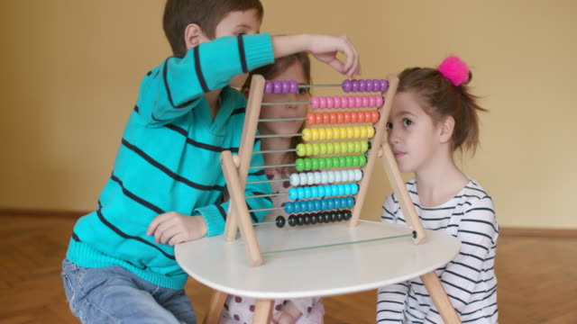 Children with abacus, slow motion