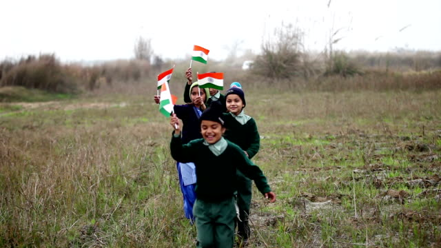 children with indian flag in the nature - indian flag stock videos & royalty-free footage