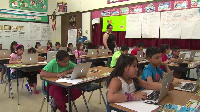 children with laptops in a classroom at piper elementary on june 3, 2014 in chicago. - human interest stock videos & royalty-free footage