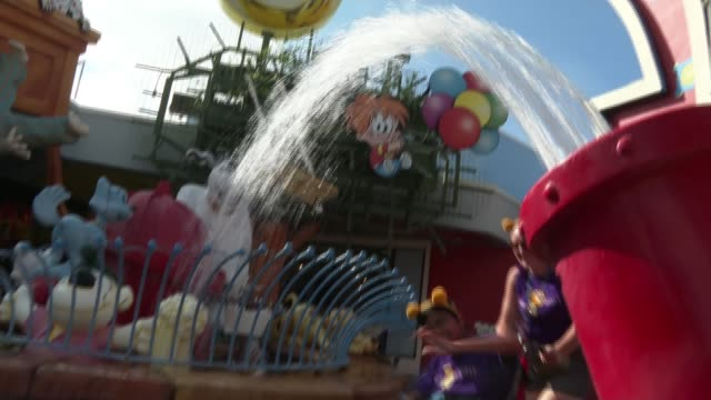 200 children with serious illnesses and disabilities enjoy trip to florida orlando florida usa various shots of disabled children enjoying day at... - roller coaster stock videos & royalty-free footage