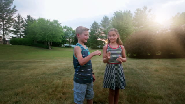 children with sparklers on Fourth of July