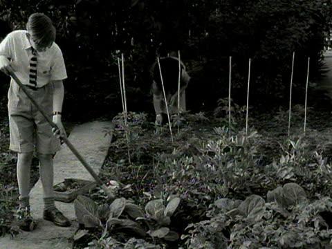 children work in their school garden 1954 - gardening stock videos & royalty-free footage