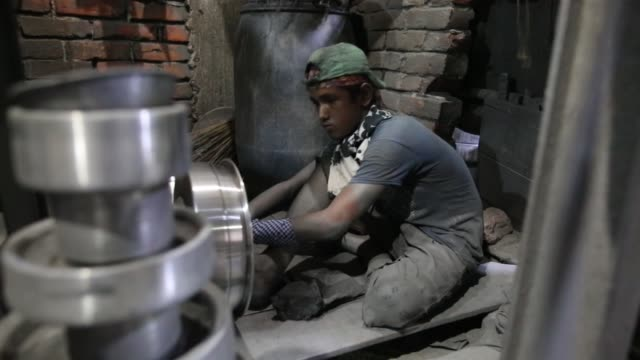 children working inside aluminium pot making factory in dhaka, bangladesh on may 23, 2017 / factory owner use these children for cheap wages / they... - school child stock videos & royalty-free footage