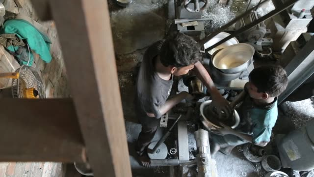 Children working inside Aluminium pot making factory in Dhaka Bangladesh on May 23 2017 / Factory owner use these children for cheap wages / They...