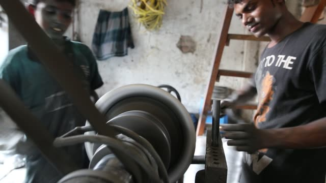 children working inside aluminium pot making factory in dhaka bangladesh on may 23 2017 / factory owner use these children for cheap wages / they... - the machine: master or slave stock videos & royalty-free footage