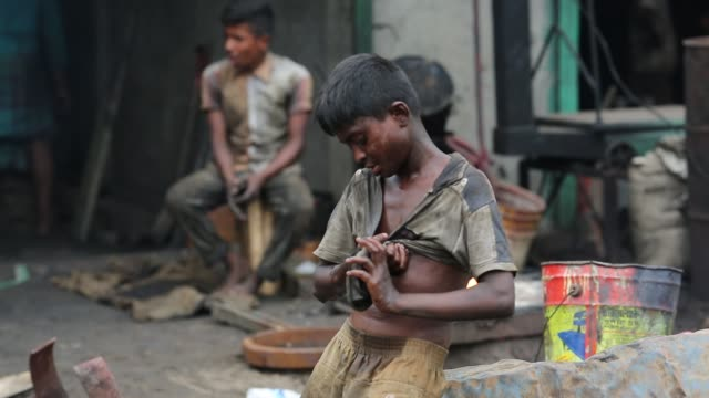 Children works in ship repairing yard near the Buriganga River in Dhaka on May 07 2018 There are more than 35 shipyards in Old Dhaka's Keraniganj...
