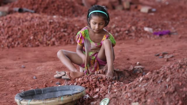 Children works with their mother where they break bricks in Dhaka Bangladesh on March 06 2018 Child labor work for helping her family with her mother...