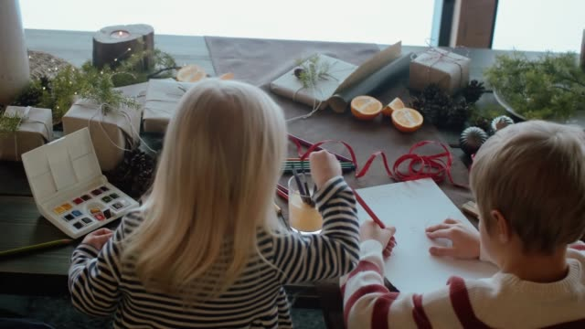 children writing a letter to santa claus (slow motion) - scandinavian culture stock videos and b-roll footage