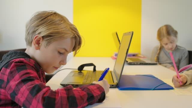 children writing at desk - 45 49 anni video stock e b–roll
