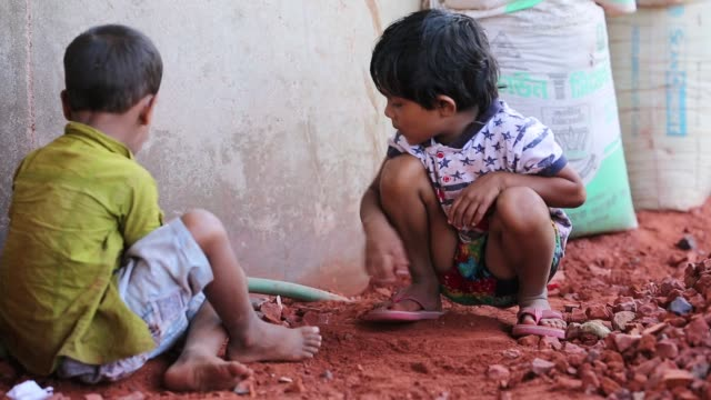 Children's are play where their mother break bricks in Dhaka Bangladesh on March 06 2018 With over half of the population living below the poverty...
