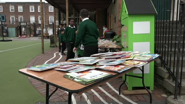 children's book project rehomes 500,000th book with plans to open a free bookshop to get more pupils reading; england: chelsea: park walk primary... - bookshelf stock videos & royalty-free footage