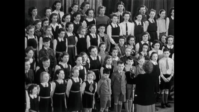 b/w a children's choir singing / united kingdom - 賛美歌点の映像素材/bロール