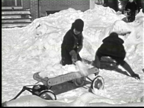 b/w childrens cleaning snow and skating in snow, ottawa, canada / audio - work tool stock videos & royalty-free footage