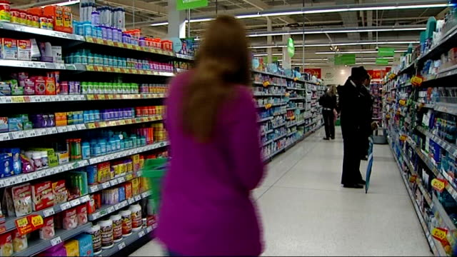 Children's cold remedies largely ineffective say doctors T27030842 Shopper carrying basket along up supermarket aisle past shelves filled with...