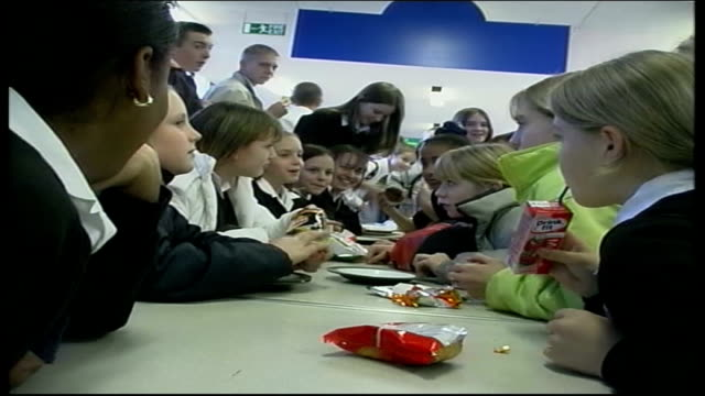 children's eating habits england southampton int mss schoolchildren eating at table in school canteen cms boy eating chocolate eclair - cream cake stock videos & royalty-free footage