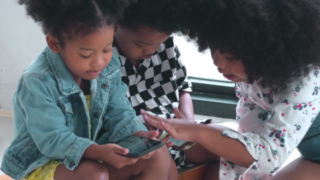 children's group using smart phone - young family stock videos & royalty-free footage