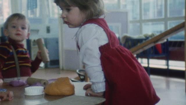 vídeos de stock, filmes e b-roll de 1983 montage children's health clinic / united kingdom - brincalhão