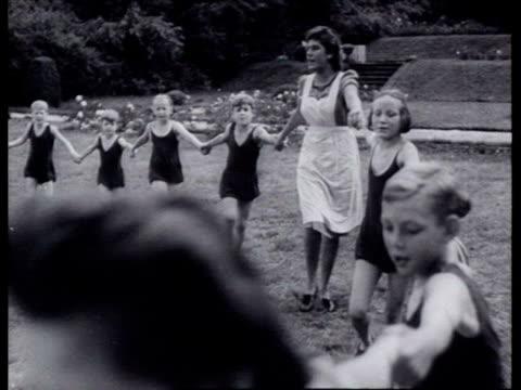 vídeos y material grabado en eventos de stock de children's home of nsb on estate children playing outdoors / netherlands - orfanato