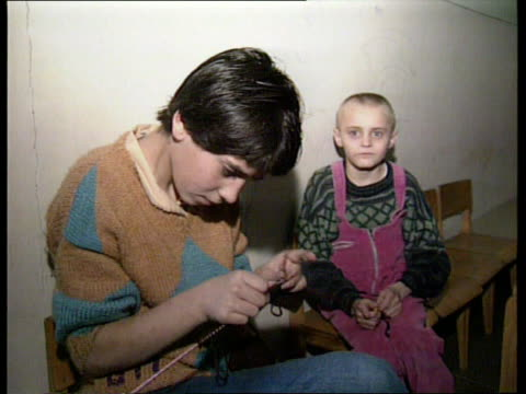 children's hospital bombed: charities' response; bosnia-herzegovina sarajevo gv children in front of bomb damaged building tilt down r-l cms two... - one baby boy only stock videos & royalty-free footage