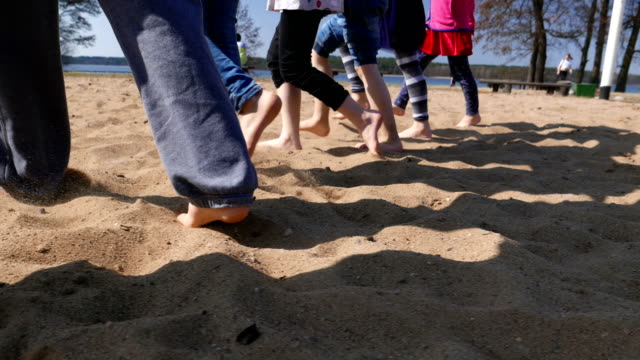 children's legs marching in the row on the sand. - rhythm stock videos & royalty-free footage
