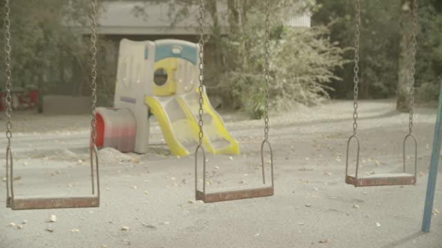 ensenada, chile - april 27, 2015: children's playground covered in volcanic ash - in rovina video stock e b–roll
