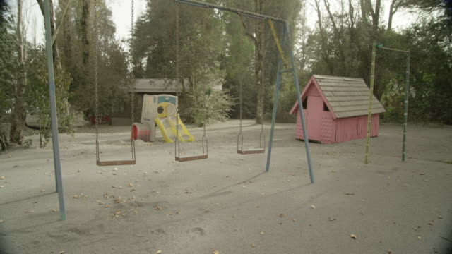 ensenada, chile - april 27, 2015: children's playground covered in volcanic ash - abbandonato video stock e b–roll