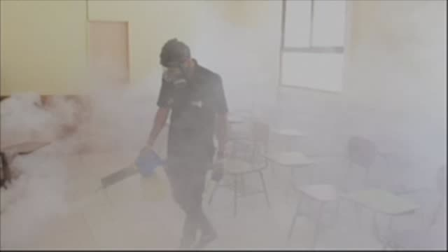 children's school in san jose costa rica is covered in a dense vapour as workers disinfect desks lockers and floors in a country which has registered... - san jose costa rica stock videos & royalty-free footage