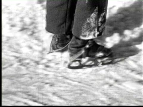 b/w cu childrens skating in snow, ottawa, canada / audio - ottawa stock videos & royalty-free footage