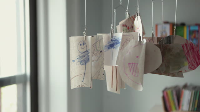 ms child's drawings hanging in room / brooklyn, new york city, usa - husinteriör bildbanksvideor och videomaterial från bakom kulisserna