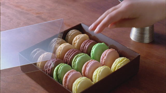 cu, child's (6-7) hand taking macaroon from box - unknown gender stock videos & royalty-free footage