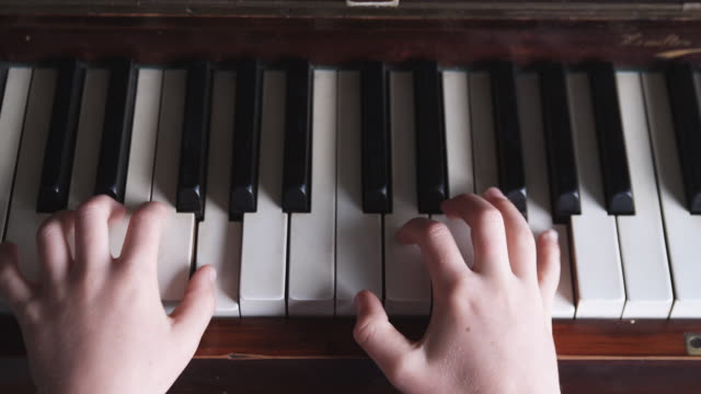 cu childs hands playing piano / new zealand  - piano stock videos & royalty-free footage
