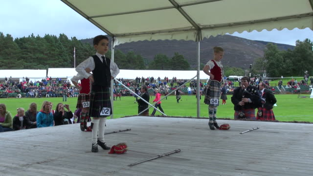 ms childs highland dancing at braemar royal highland games / braemar, aberdeenshire, scotland - highland games stock videos & royalty-free footage