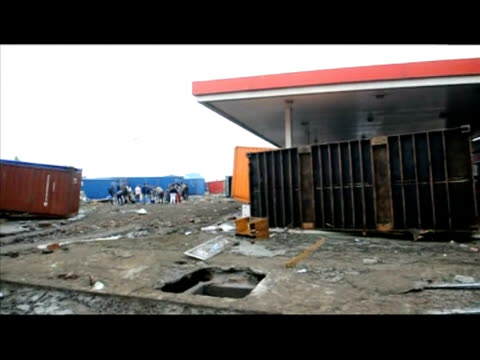 chile called for international aid monday as the anguished calls of trapped quake survivors pierced the rubble and police had to arrest 160 looters... - rubble stock-videos und b-roll-filmmaterial