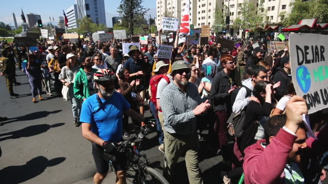 chilean captain planet march in support of the global climate strike at plaza italia on september 20, 2019 in santiago, chile. strikes are being held... - south america stock videos & royalty-free footage