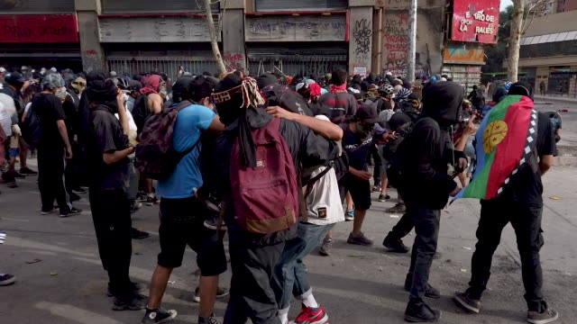 chilean demonstrator during protests against president sebastián piñera on november 13, 2019 in santiago, chile. yesterday president of chile... - barricade stock videos & royalty-free footage