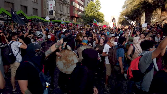 chilean demonstrator during protests against president sebastián piñera on november 13, 2019 in santiago, chile. yesterday president of chile... - chile stock videos & royalty-free footage