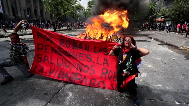 chilean demonstrator protest during the sixth day of protest against president sebastian piñera on october 23 2019 in santiago chile although... - chile stock videos & royalty-free footage