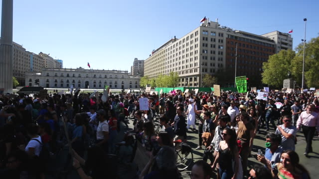 chilean demostrator pass in front of presidential palace la moneda during march in support of the global climate strike at plaza italia on september... - climate stock videos & royalty-free footage