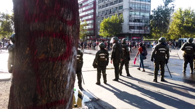 chilean people protest against the government of president sebastian piñera on december 20, 2019 in santiago, chile. mayor felipe guevara announced... - fare video stock e b–roll