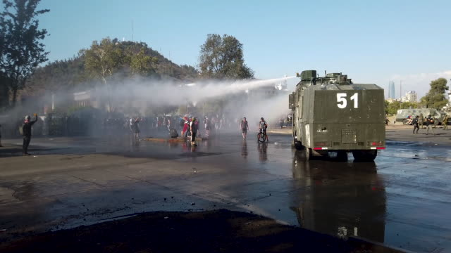 chilean people protest against the government of president sebastian piñera on december 20, 2019 in santiago, chile. mayor felipe guevara announced... - water cannon stock videos & royalty-free footage