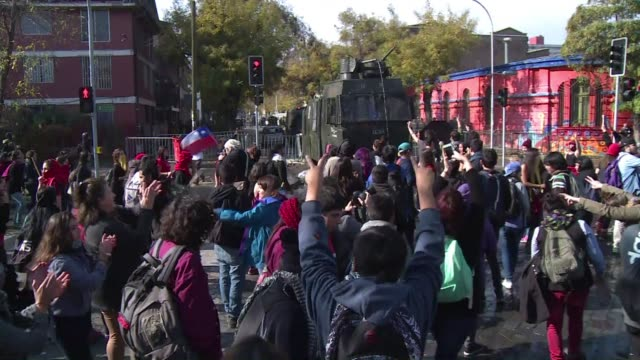 chilean police fired tear gas and water cannon wednesday to break up a large student protest that turned violent on the eve of the copa america, the... - water cannon stock videos & royalty-free footage